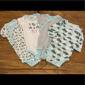 Set of 4 newborn onesies